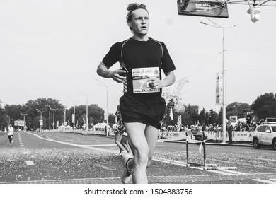 September 9, 2018 Minsk Belarus Half Marathon Minsk 2018 Athlete crosses the finish line when running a marathon in black and white