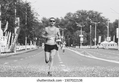 September 9, 2018 Minsk Belarus Half Marathon Minsk 2018 Athlete runs a marathon on the road in black and white