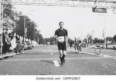 September 9, 2018 Minsk Belarus Half Marathon Minsk 2018 Marathon runner joyfully crosses the finish line in black and white