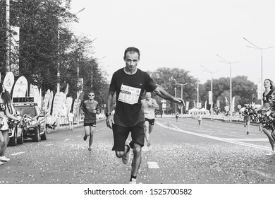September 9, 2018 Minsk Belarus Half Marathon Minsk 2018 Athletes run half marathon next to cheerleaders in black and white