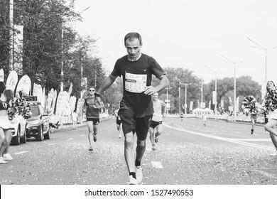 September 9, 2018 Minsk Belarus Half Marathon Minsk 2018 Athlete runs a marathon along the road in black and white