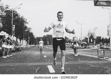 September 9, 2018 Minsk Belarus Half Marathon Minsk 2018 Tired athlete crosses the finish line in black and white