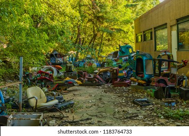 September 9, 2018; Seoul, South Korea: Discarded parts of rides of bankrupt amusement park in disrepair behind old building.