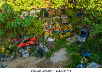 September 9, 2018; Seoul, South Korea: Discarded parts of rides of bankrupt amusement park in wooded area.