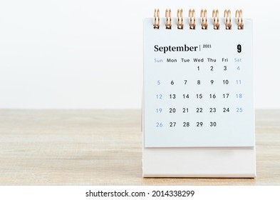 September Calendar 2021 on wooden table background.