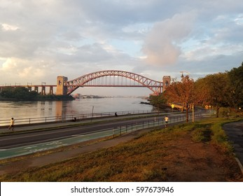 A September morning view of the Hell Gate Bridge from Astoria Park in Astoria, Queens, NY, United States.