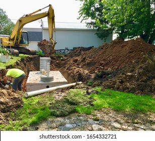 Septic holding tanks being put in the ground