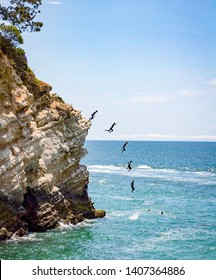 sequence of cliff jumping into ocean