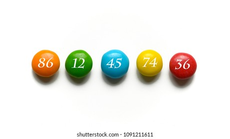 sequence of numbers on colored smarties - white background - closeup