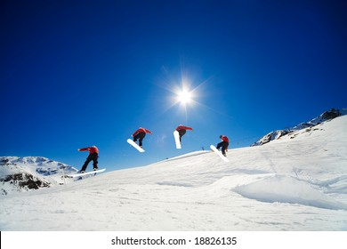 Sequence shot of snowboarder going over jump