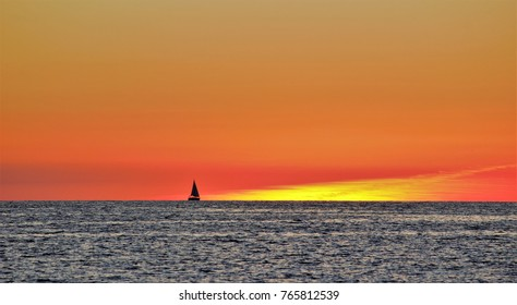 sequence of travel of a sailboat during sunset in the Mediterranean Sea, peace, calm, serenity, harmony, fullness, well-being, nature, natural, contemplate, meditate, breathe, grow, happiness,