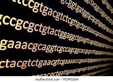 Sequencing the genome. Background on the subject of DNA sequencing, symbols of nucleotide bases on the dark.
