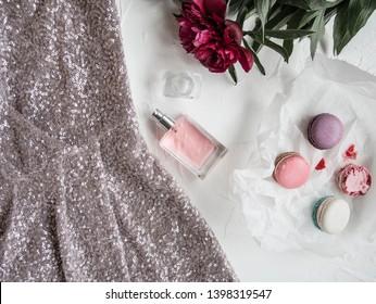 Sequin beaded  evening dress flatlay top view perfume bottle fashion. Women's fragrance