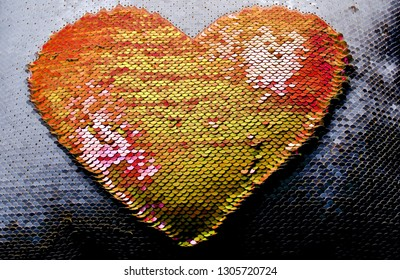 Sequin Heart created from reversible sequins. Yellow, orange, and coral colored sequins.