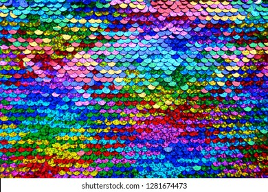 Sequins background.Multicolored sequins.Rainbow. Scales background. Paillette fabric background.sparkling sequined textile