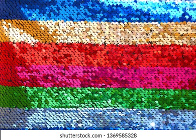Sequins background.sequins striped fabric.Texture scales with Sequins close-up.Sequins multicolored stripe.Scales background.Shiny texture sequin material