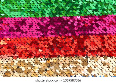 Sequins background.sequins striped fabric.Texture scales with Sequins close-up.Sequins multicolored stripe.Scales background.Shin sequin material