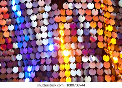 Sequins close-up macro. Abstract background with sequins colorful on the fabric.