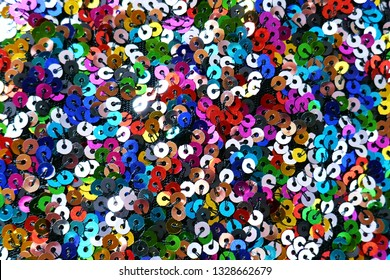 Sequins macro background.Multicolored sequins.shiny rainbow fabric.Scales background. fabric background.sparkling sequined textile