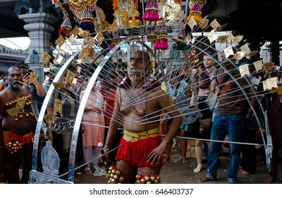 Serangoon, Singapore - January 30, 2010:  A devotee carrying a kavadi in Thaipusam the hindu festival, Singapore