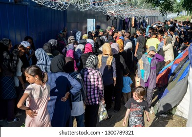 Röszke, Horgoš, Serbia, 06th July 2016. Refugees and migrants from Syria and Iraq are trapped on closed border between Serbia and Hungary. European migrant crisis. Camp. Hungarian police guard