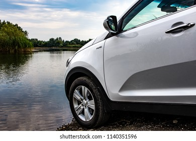 Serbia - 07.22.2018 / car Kia Sportage 2.0 CRDI awd or 4x4, white color, preparing to crosses the lake, beautiful car, and very nice to drive.