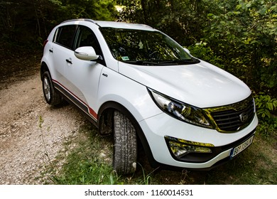 Serbia - 08.01.2018 / car Kia Sportage 2.0 CRDI awd or 4x4, white color, stuck on a trench on a Tara mountain near lake Zaovine, with one wheel in the air, and others on grass.