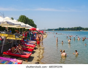Serbia, Belgrade, Ada Ciganlija lake, July 2017. Picture is showing people on a beach and in restaurants in Ada Ciganlija lake resort.