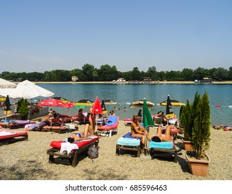 Serbia, Belgrade, Ada Ciganlija lake, July 2017. Picture is showing people on a beach in Ada Ciganlija lake resort.