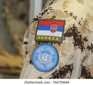 Serbia; Belgrade; June 6, 2017; Serbian flag and UN logo on yellow camouflage uniform; The 8th International Armament Fair from 27th to 30th June.