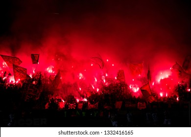SERBIA, BELGRADE - March 2, 2019: Football fans with torches during the eternal rivals have met in the Eternal soccer derby, FC Partizan and FC Red Star, was played on 2 March in Belgrade