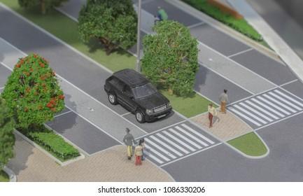 Serbia; Belgrade; March 24, 2018; Miniature model stopped Range Rover in front of crosswalk with pedestrians; Belgrade Waterfront