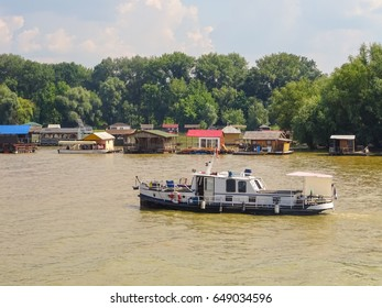 Serbia, Belgrade, May 2017. Picture is showing a small boat on river Sava and boat houses on the river.