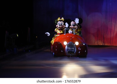 SERBIA, BELGRADE - NOVEMBER 1, 2013: Disney characters Mickey Mouse and Minnie Mouse riding in a car at Disney on Ice show / cartoon heroes