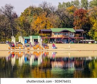 Serbia, Belgrade. Restaurant at a shore of a lake Ada Ciganlija in autumn.