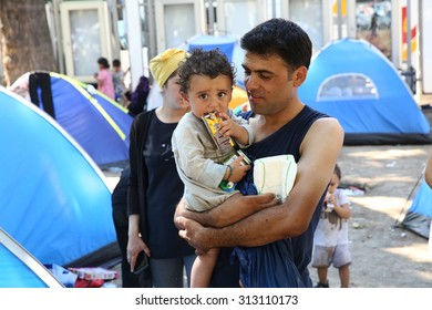 SERBIA, BELGRADE - September 01,2015: Park at the station migrants from Syria have turned into a small city. Some have even set up tents and in which they reside, while most sleep under the open sky.