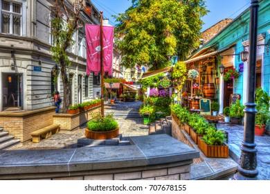 SERBIA, BELGRADE - SEPTEMBER 1: The beginning of the Skadarska street on September 1, 2017 in Belgrade. Old restaurants, cobblestones and lots of greenery. HDR Image.