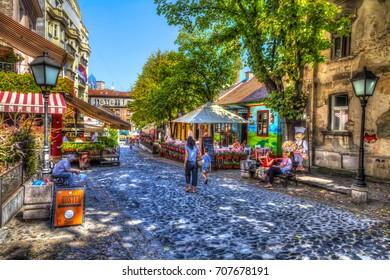 SERBIA, BELGRADE - SEPTEMBER 1: Restaurant Hat my in Skadarska street on September 1, 2017 in Belgrade. Old restaurants, cobblestones and lots of greenery. HDR Image.