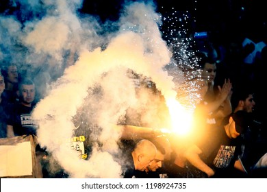 SERBIA, BELGRADE - September 23, 2018: Football fans with torches during the eternal rivals have met in the Eternal soccer derby, FC Partizan and Red Star, was played on 23 September in Belgrade