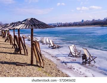 Serbia, Belgrade, Winter 2017.  Chairs on icy lake Ada Ciganlija.