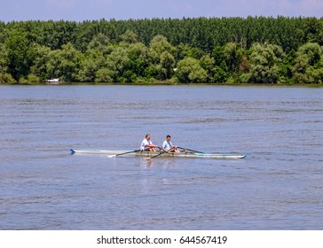 Serbia, Belgrade, Zemun, May 2017. Picture is showing a rowing boat with two rowers on Danube river near Zemun, a suburb of Belgrade.