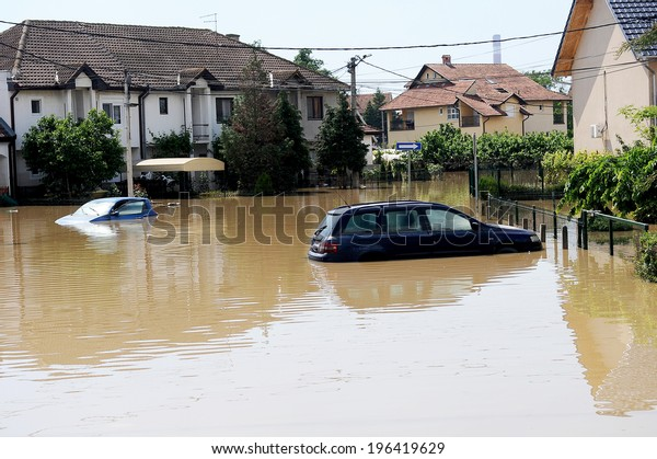 SERBIA, OBRENOVAC - MAY 21: House and street in Obrenovac under water. The water level of Sava River remains high in worst flooding on record across the Balkans on may 21, 2014