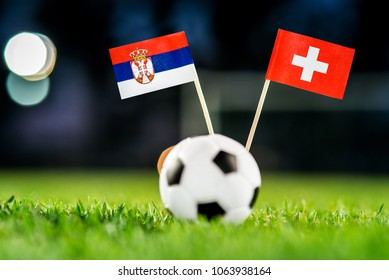 Serbia - Switzerland, Group E, Friday, 22. June, Football, World Cup, Russia 2018, National Flags on green grass, white football ball on ground.