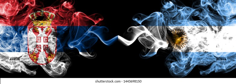 Serbia vs Argentina, Argentinian smoky mystic flags placed side by side. Thick colored silky smokes combination of Serbian and Argentina, Argentinian flag