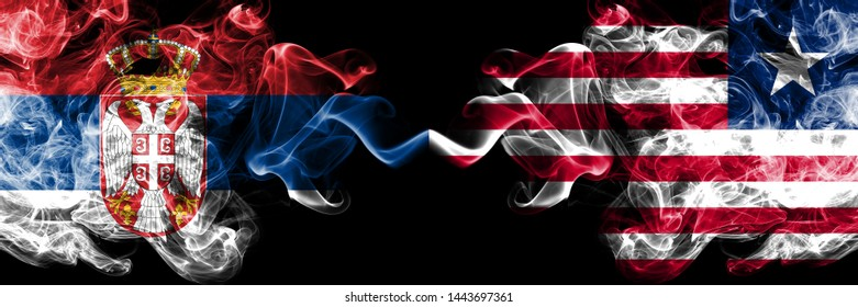 Serbia vs Liberia, Liberian smoky mystic flags placed side by side. Thick colored silky smokes combination of Serbian and Liberia, Liberian flag