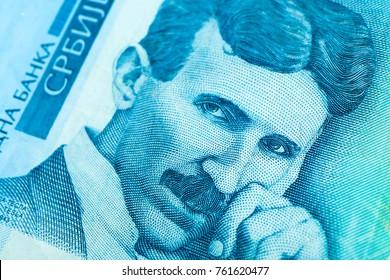 Serbian 100 dinara currency banknote, close up. Serbia money RSD dinar cash, macro view, portrait of scientist Nikola Tesla.