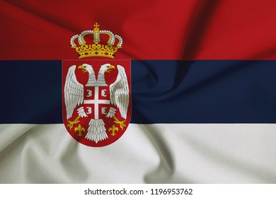Serbian flag, with a fabric texture