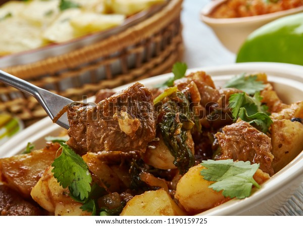 Serbian Goulash-Paprikash, Balkan cuisine cuisine, Traditional assorted dishes, Top view.ade with onions, olive oil, lamb, bay leaves, tomato paste, water, paprika, red chile.