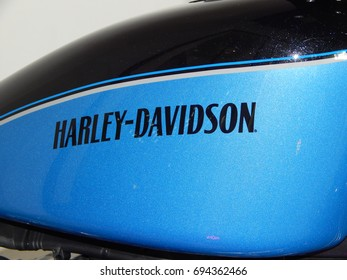 SERDANG, MALAYSIA -JULY 29, 2017: Various design of Harley-Davidson motorcycle logos printed at the motorcycle. Some of the logo was costume made by owner.