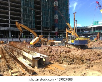 SERDANG, MALAYSIA -JUNE 13, 2016: Construction site in progress at Serdang, Malaysia during daytime. Construction machine busy with their work.